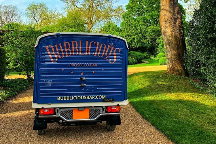 Rear panel of the customised blue Tuk Tuk with Bubblicious branded on the back