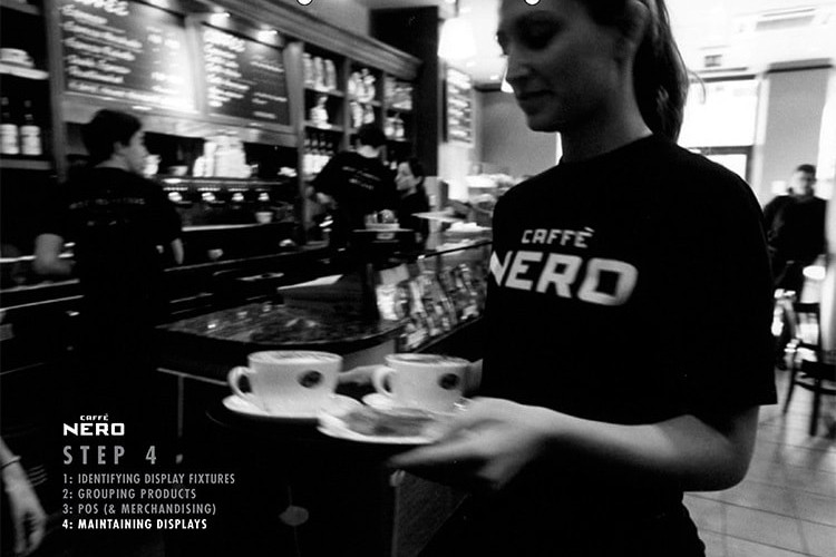 Black and white image of a woman with Caffè Nero t-shirt walking with coffee cups in her hand for Caffè Nero manual dividers
