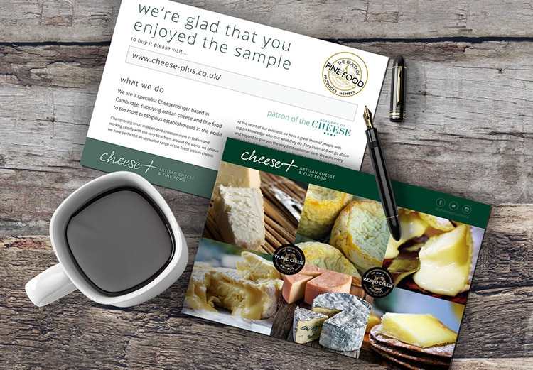 Front and back of Cheese plus branded postcards with grided imagery of cheese