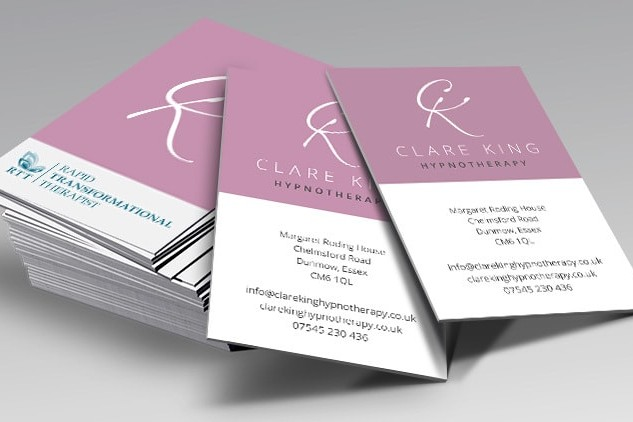 Business cards spread apart with Clare King branding
