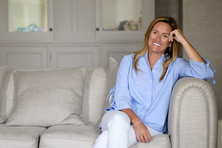 Woman sitting on sofa photography for Clare King