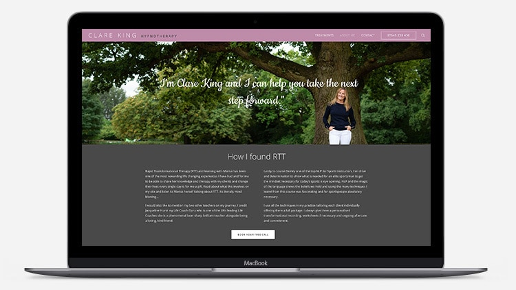 Laptop showing Clare King website design with image of woman under a tree