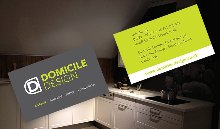 Domicile Design front and back business cards with dark kitchen background