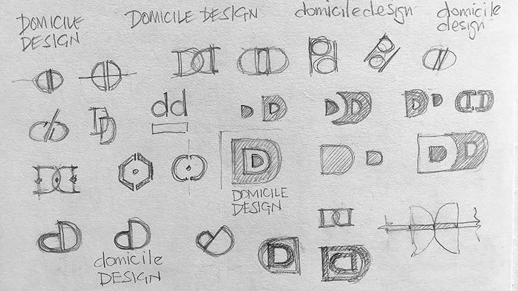 Conceptual sketches showing the development of the Domicile Design symbol design