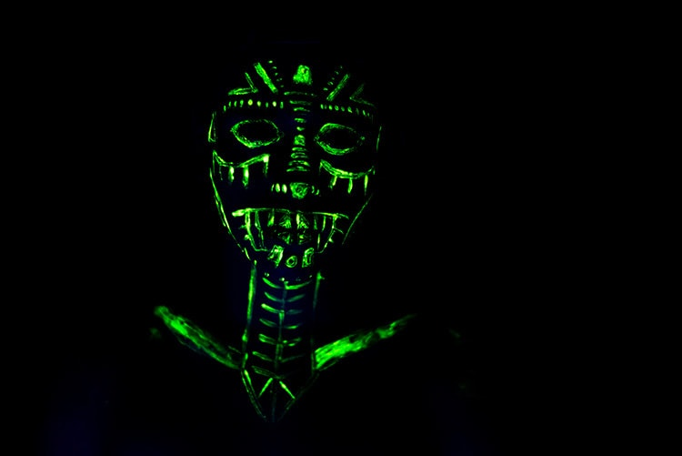 Person with green glowing face paint