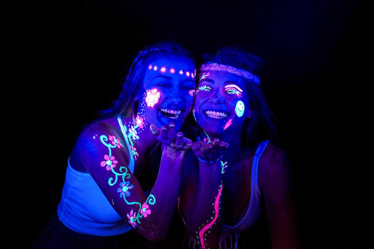 People with glowing face paint