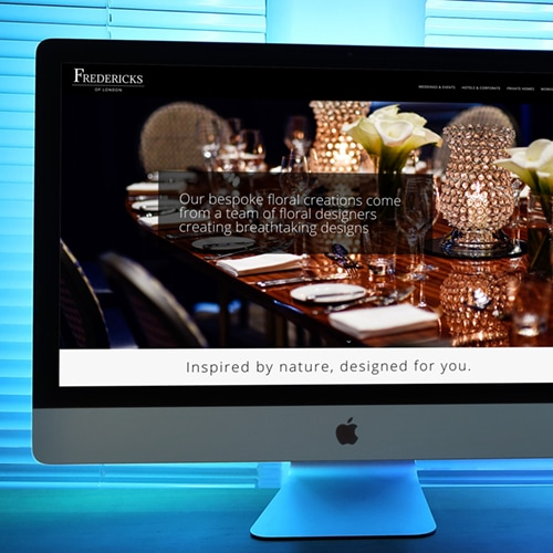 Fredericks of London Homepage Website Design Desktop with blue lit background Thumbnail