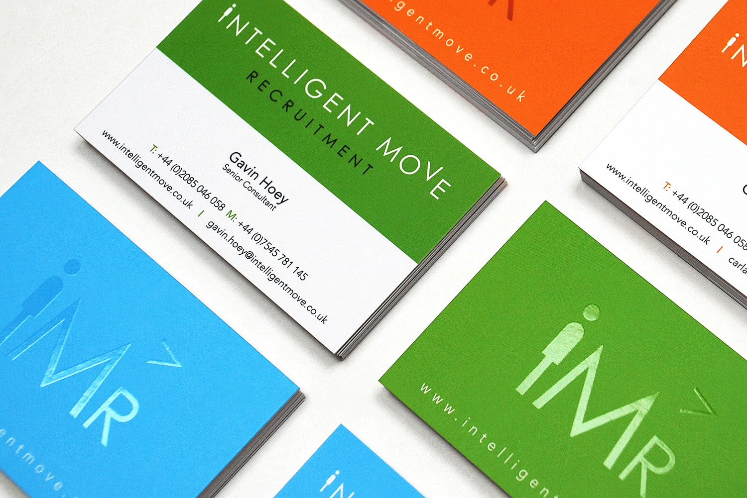 Close up of front and back of Intelligent Move Recruitment business cards