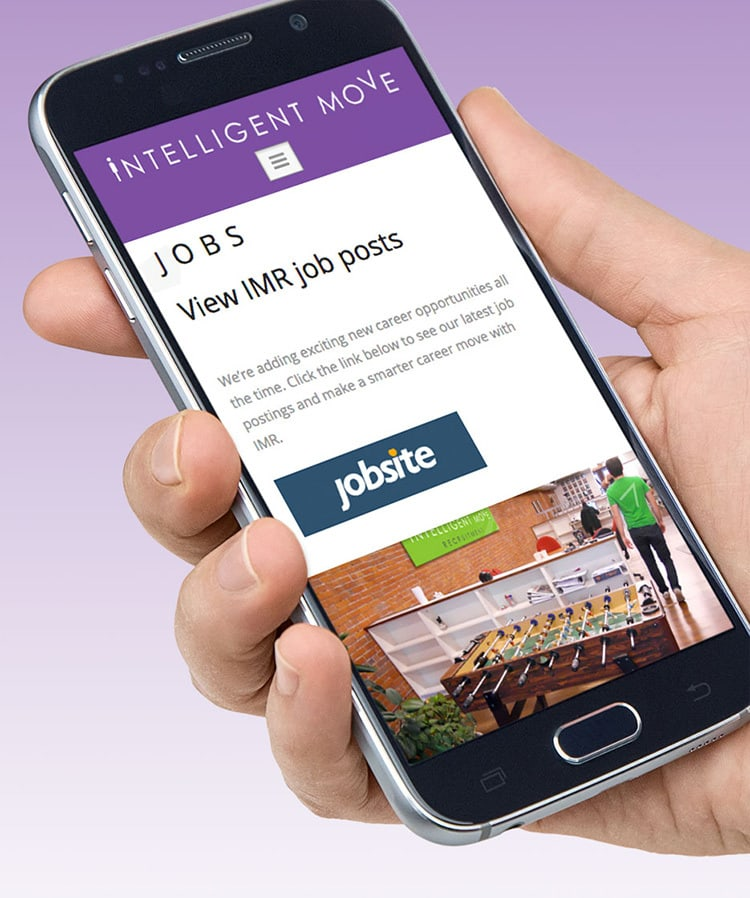 A person holding mobile phone viewing Intelligent Move Recruitment website