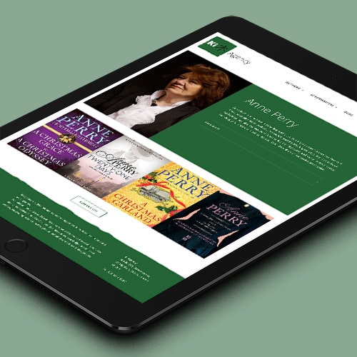 Tablet laying flat displaying home page of Ki Agency responsive website design Thumbnail