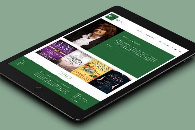 Tablet laying flat displaying home page of Ki Agency responsive website design