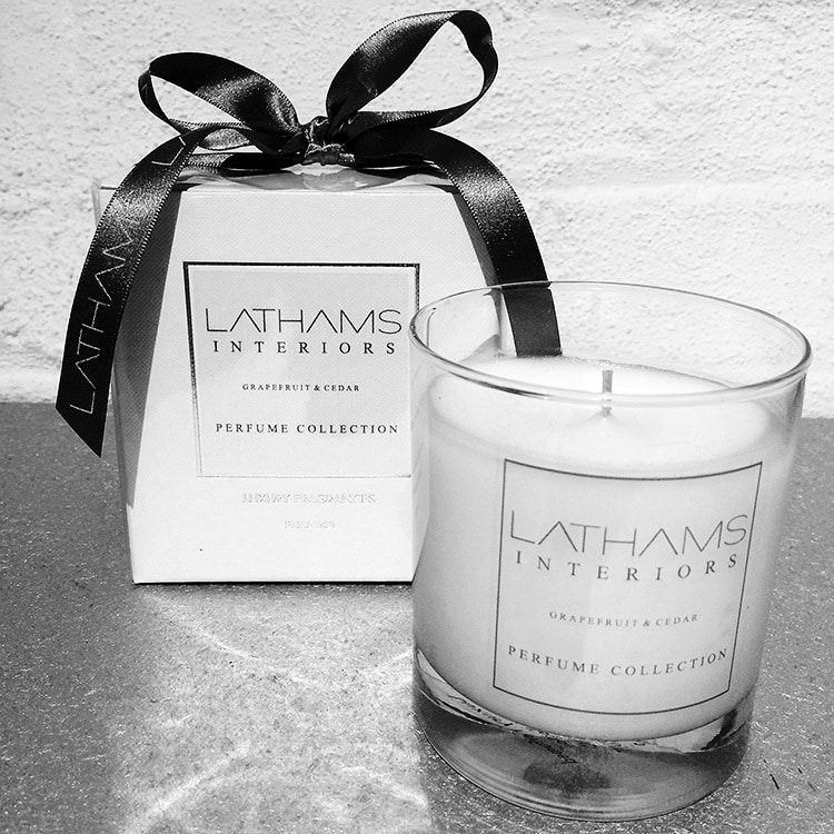 Close up of Lathams branded candle and candle box with a bow for Website