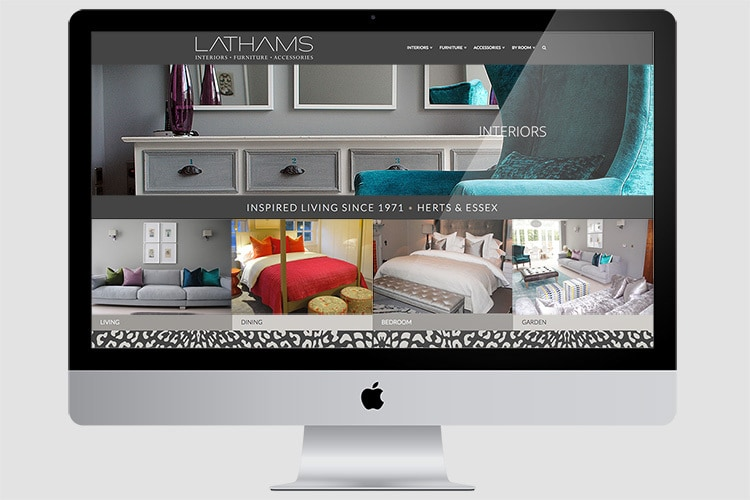 Desktop PC displaying homepage website design for Lathams