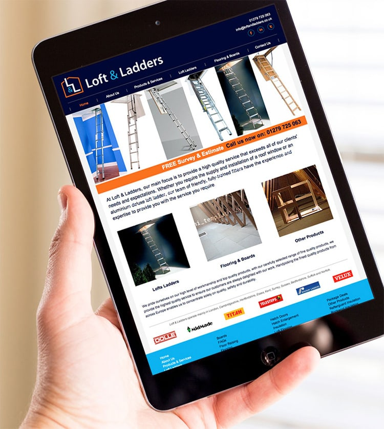 A person holding a tablet viewing the Loft & Ladders responsive website design