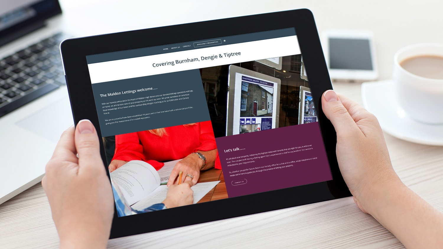 A person holding a tablet viewing the responsive Maldon Lettings website