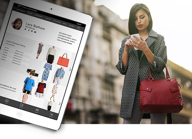 A woman with a red purse holding a phone and tablet showing website photography for Proximity Insight