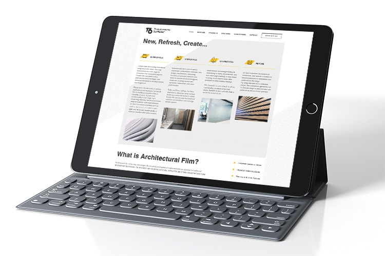 Tablet with keyboard display homepage of T6 responsive website design