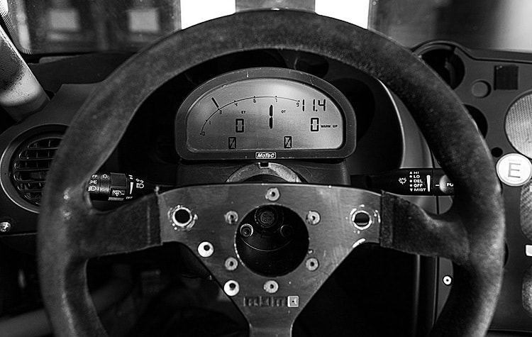 The racecar steering wheel and driver cockpit photography for Walero