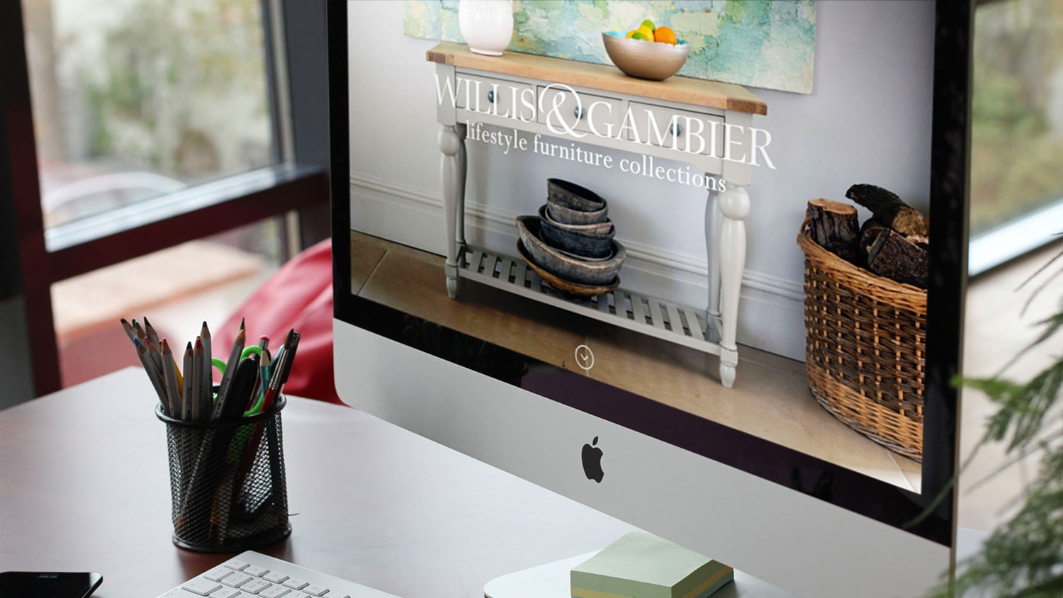Close up of desktop displaying the Willis & Gambier website with a full bleed image of Willis & Gambier furniture