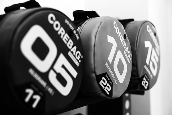 Retouched and enhanced close up of three core bags resting on a rack