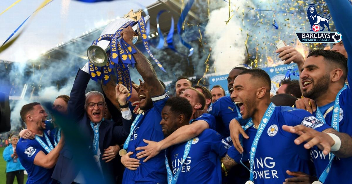 Leicester City team holding a trophy celebrating them winning the 2016 Premier League