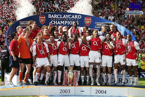 The Arsenal team celebrating their second Premier League title in 2004