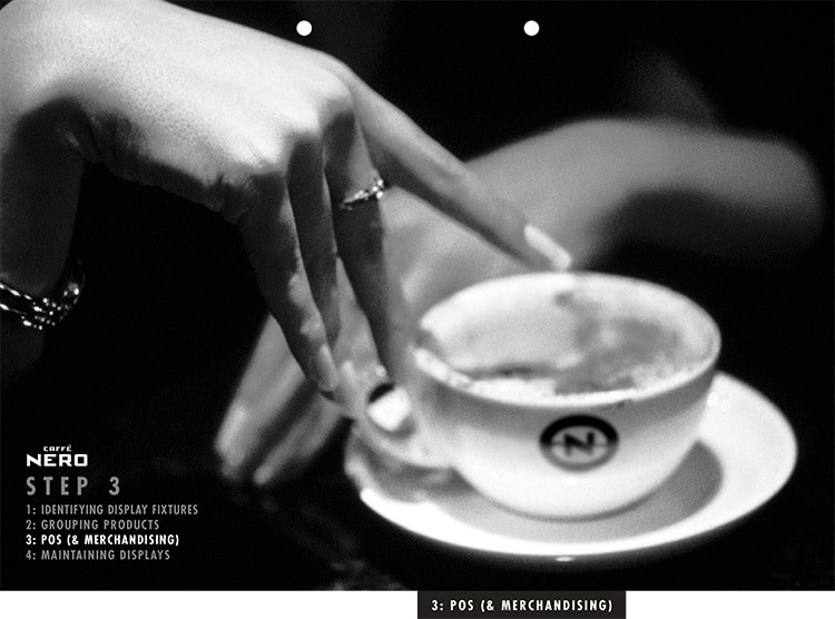 Black and white image of a person reaching for coffee cup for Caffè Nero manual dividers