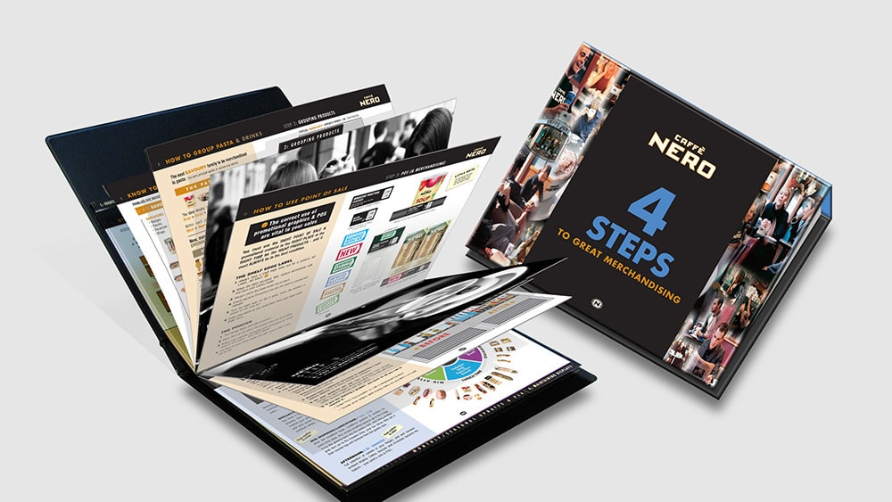 Caffè Nero Visual Merchandising Manual print design showing front cover and open spread Thumbnail