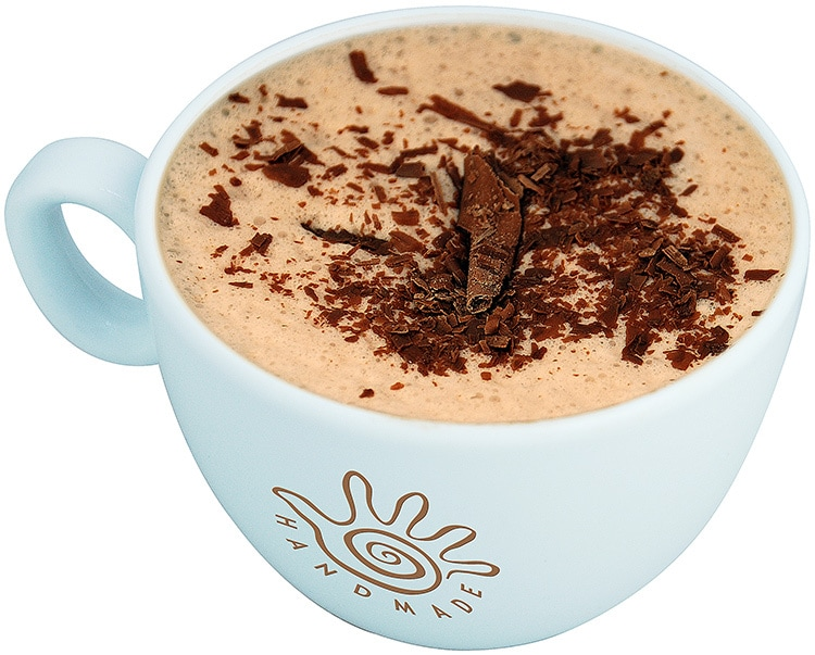 Close up of hot chocolate with chocolate shavings in Marimba branded mug