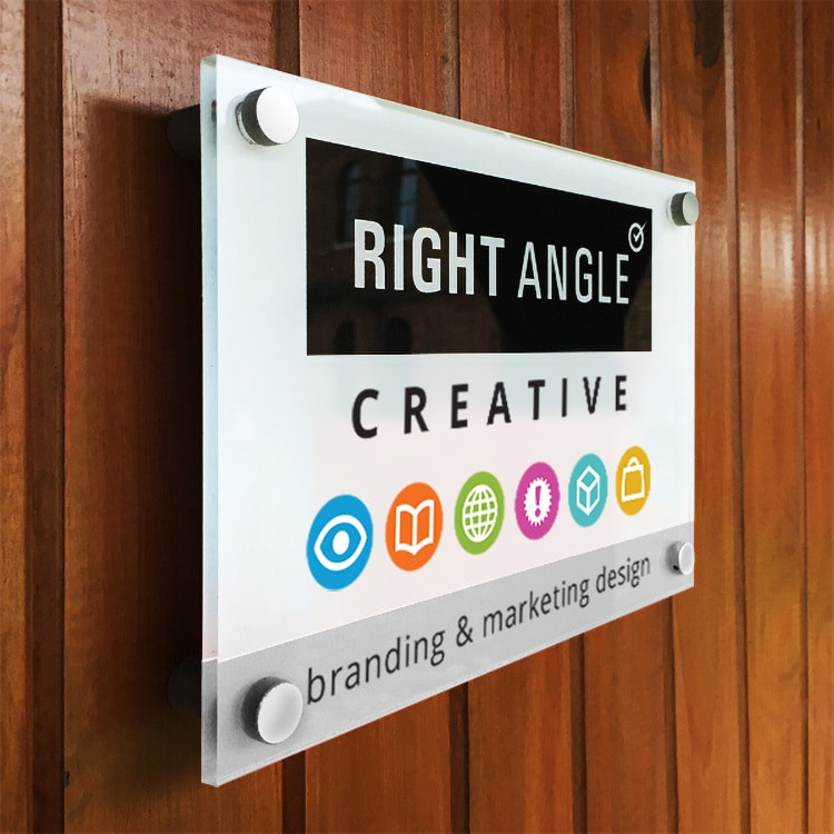 Close up of Right Angle Creative with symbols and strapline sign on a wooden door
