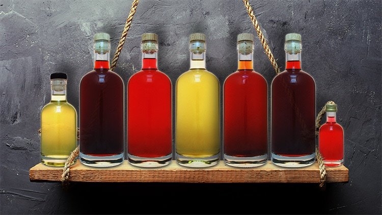 A lineup of flavoured drinks on wooden shelf with no labels photography for So Drinks