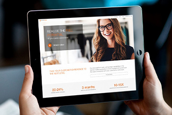 A person holding a tablet viewing the new responsive website design for Proximity Insight
