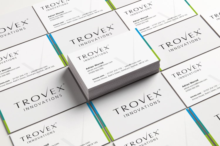 Stacks of business cards showing the front and back design for Trovex Innovations