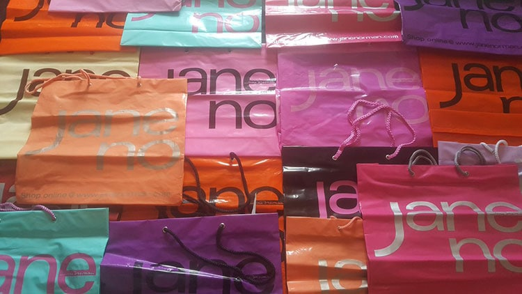 Jane Noman bags stacked on top of each other