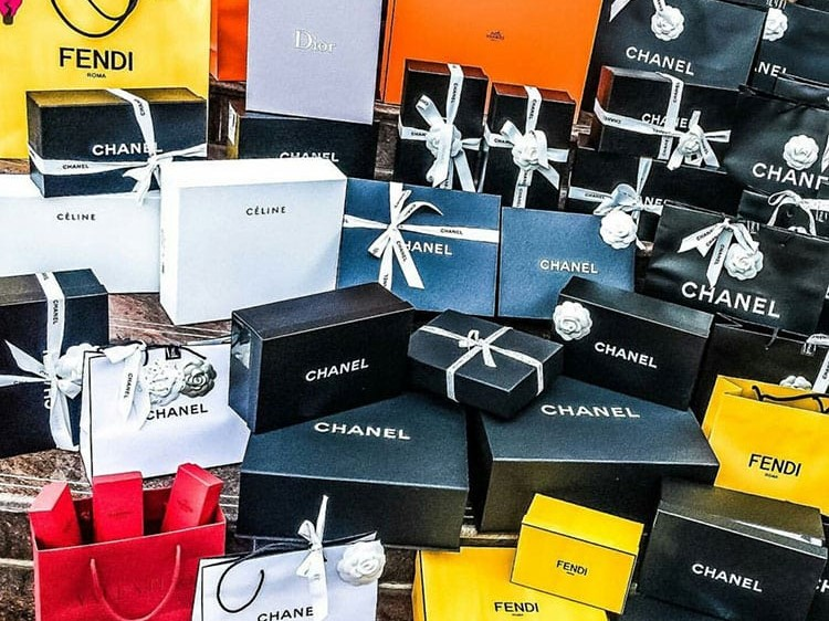 Luxury Chanel boxes with bows stacked ontop