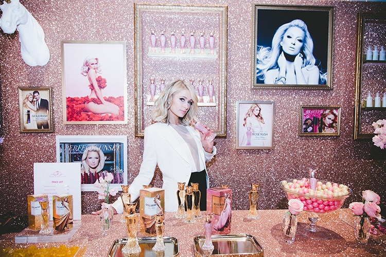 Paris hilton showcasing her perfume line