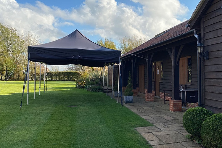 Black Gazebo in front of studio